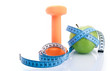 Dumbbell with apple and measure tape