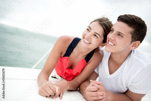 Couple sailing on a boat