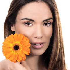 Beautiful smiling woman with flower