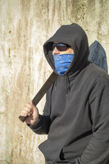 Man with mask and machete in hands