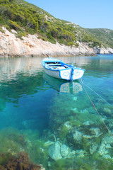 Romantic boat with painted hearts floating on transparent sea wa
