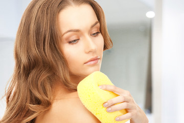 beautiful woman with sponge