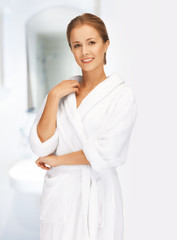 beautiful woman in white bathrobe