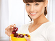 healthy woman holding bowl with cherries