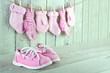 Pink toddler shoes on wooden light green background
