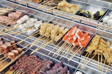 Raw food on skewers in asian market, Penang, Malaysia
