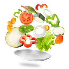 Assorted fresh vegetables flying in a plate