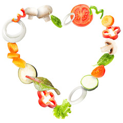 Heart of fresh vegetables flying in a plate