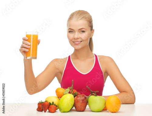 young woman with glass of orange juice