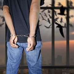 Prisoner locked in handcuffs
