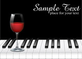 wine glass and piano key on black background
