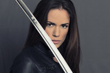 Portrait of beautiful girl with Katana