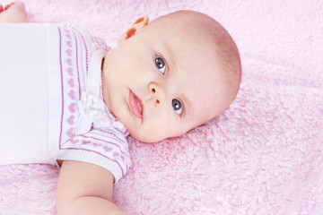 Newborn on pink blanket