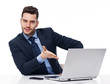 Smiling businessman showing on laptop