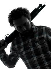 man serial killer with shotgun silhouette portrait