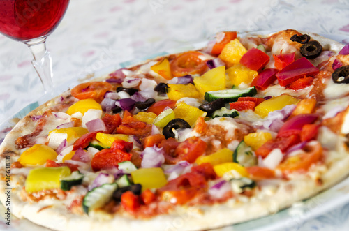 Vegetable Pizza served with a glass of Wine