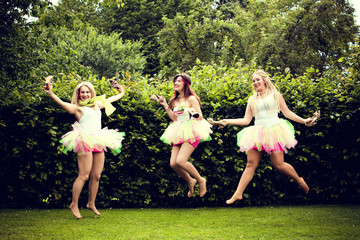 beautiful happy young women jumping.