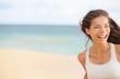Beach fun - running woman closeup with copy space