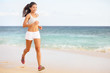 Woman runner jogging on beach
