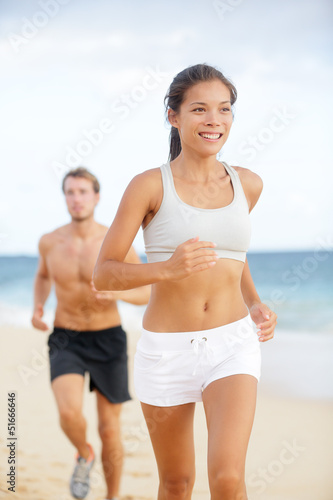 Running couple - woman fitness runner happy