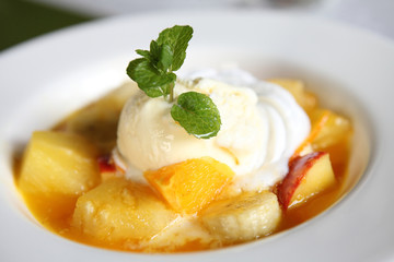 mix fruit flambe banana orange and apple with ice cream