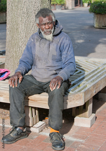 Poor old African american homeless man