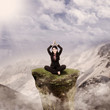 Happy businesswoman meditate in mountain