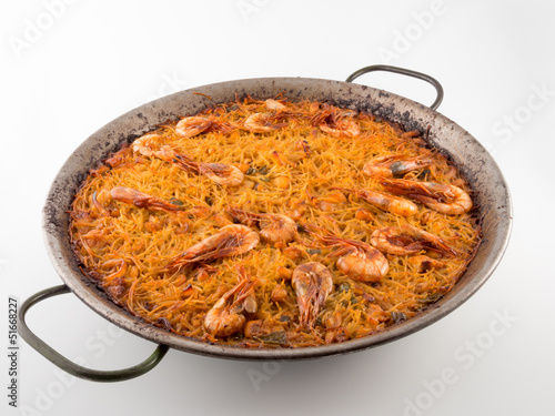 Paella with noodles, prawns, squid and fish