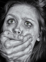 Portrait of scared woman with tears. Violence concept.