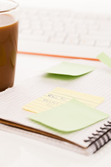 Postit attached to a notebook