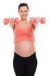 Pregnant woman working out with dumbbells