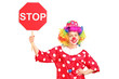 A clown holding a stop sign
