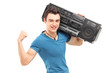 A young muscular man posing with a radio