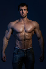 Closeup portrait of handsome muscular guy