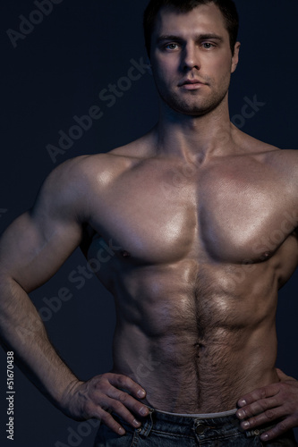 Closeup portrait of handsome muscular guy