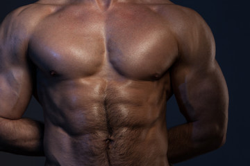 Photo of naked muscular man's torso