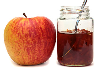Apples and glass jar with jam isolated on white background.
