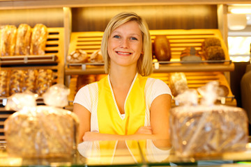 Bakery shopkeeper posing in shop