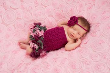 Newborn Baby Girl Wearing a Crocheted Romper