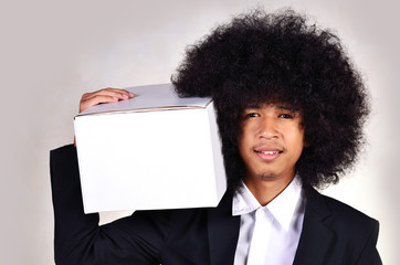 Business man holding white box