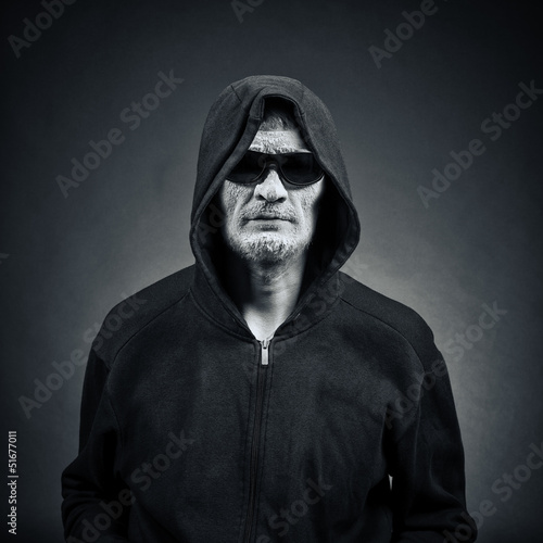 man in sunglasses and a hood