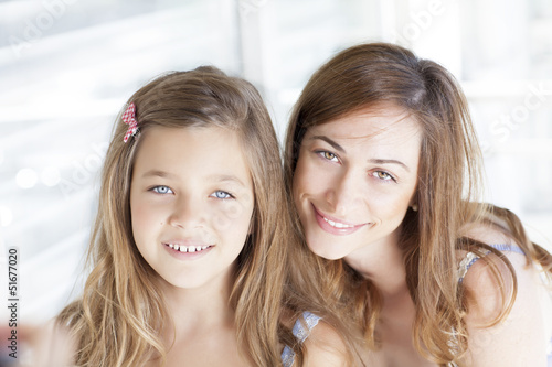 Beautiful young mother with her little daughter