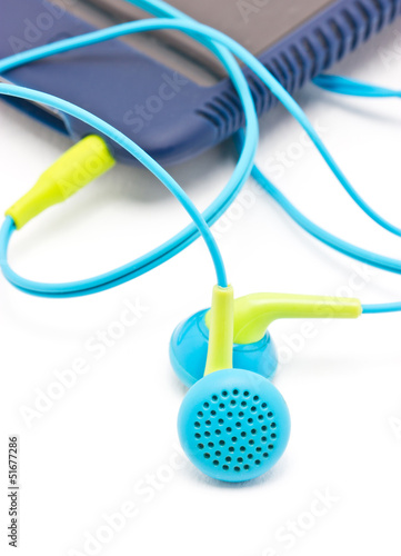 Colorful earphones with portable mp3 player isolated on white.