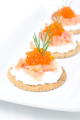 appetizer crackers with cream cheese, salmon and red caviar