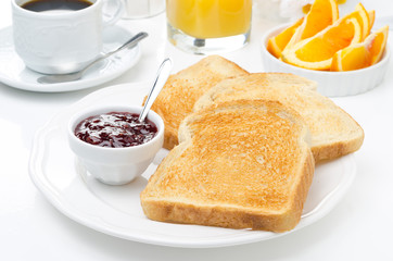 breakfast with toasts, jam, coffee and orange juice