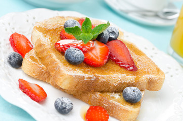 crispy toast with honey, fresh berries, cup of coffee and juice