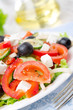 Greek salad with feta cheese, olives and vegetables, close-up