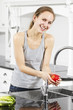 Smiling Woman wash an Apple