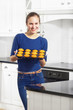 Woman holding Muffins