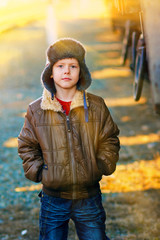 sunlight Boy homeless bum in brown jacket and a fur hat and crum